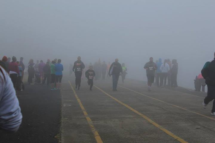 Stephen and his boy coming out of the fog to finish the race!